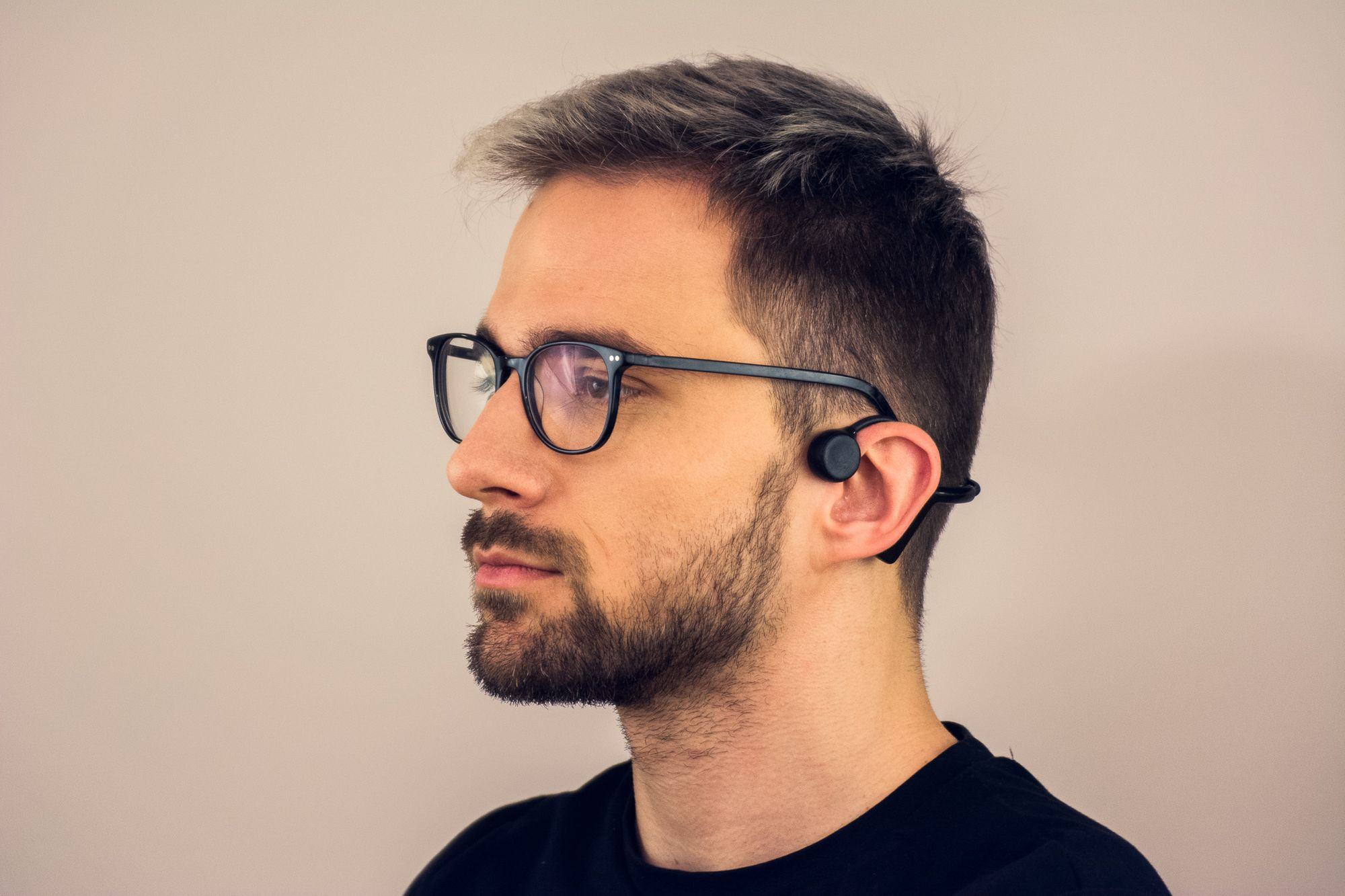 man wearing sentien audio bone conduction headphones and glasses